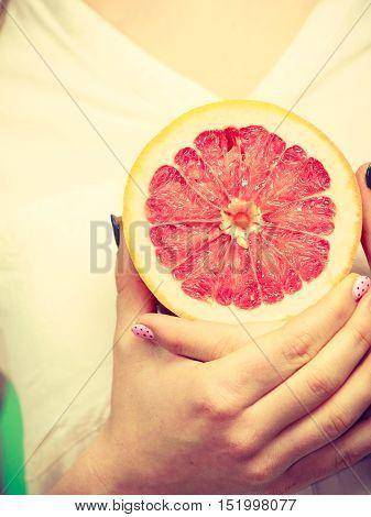 Woman Holds Half Of Grapefruit Citrus Fruit In Hand