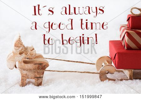 Moose Is Drawing A Sled With Red Gifts Or Presents In Snow. Christmas Card For Seasons Greetings. English Quote It Is Always A Good Time To Begin