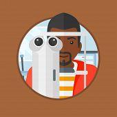 Постер, плакат: An african american man during an eye examination Man visiting optometrist Man undergoing medical