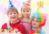 foto of birthday party  - Three kids are happily posing during birthday party - JPG