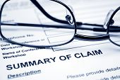 stock photo of summary  - Close up of reading glasses on Summary of claim - JPG