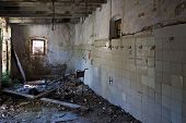 pic of slaughterhouse  - An old wheel chair in a ruined slaughterhouse - JPG