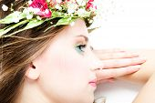 stock photo of beautiful face  - young blond woman beauty portrait with wreath of flowers studio shot - JPG