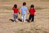 foto of walking away  - kids walking away from me at the park - JPG