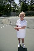 Senior Lady Plays Tennis