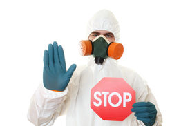 picture of gases  - Man in protective suit and respirator holding a STOP sign - JPG