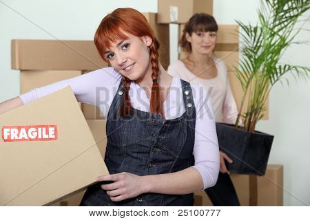 Young women on moving day