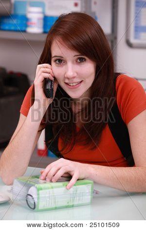 Trainee plumber on the phone