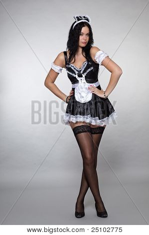Lovely Maid Posing In Uniform Flirtatious Looks In The Camera