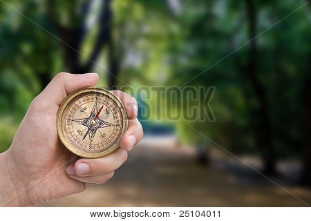 Male Hand Holding Old Compass