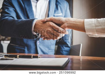 poster of Real Estate Agent And Customers Shaking Hands Together Celebrating Finished Contract After About Hom