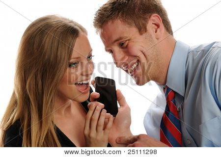 Young businesspeople couple with smart phone having fun isolated on a white background