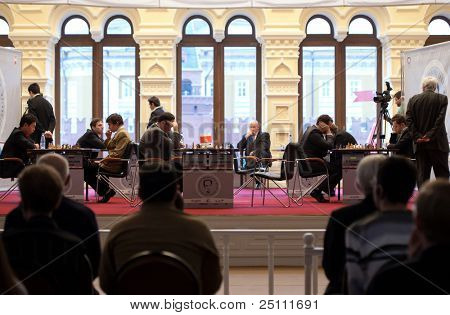 MOSCOW - NOVEMBER 4: People observe game of grand masters on Michael Tals Fifth chess memorial , November 4, 2010 in Moscow, Russia.