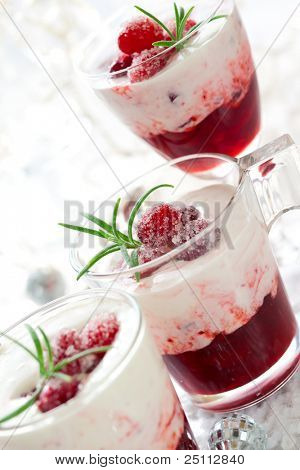 Cranberry dessert with cream and  sugared cranberries for Christmas