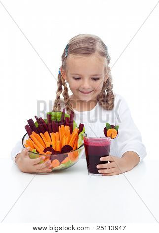 Little girl with healthy vegetables and freshly squeezed juice
