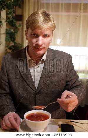 Man Eating Soup