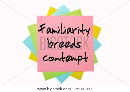"Proverb ""  Familiarity Breeds Contempt "" Written On Bunch Of Sticky Notes"