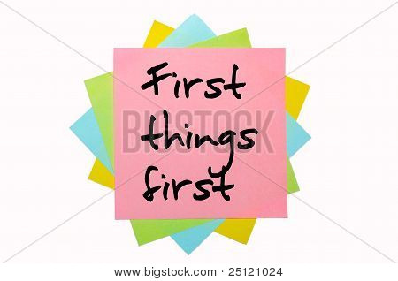 "Proverb ""  First Things First "" Written On Bunch Of Sticky Notes"