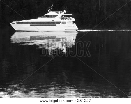 Cruise Boat On Dark River