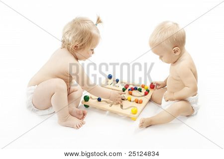 Two Babies Playing Game  over White Background