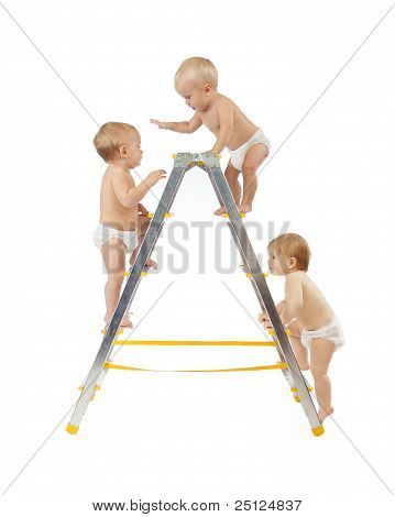 Group Of Babies Climbing On Stepladder ower White Background.