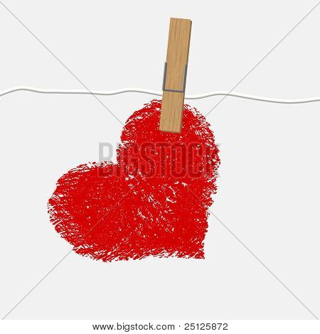 Red ragged heart attached to a clothesline with pin
