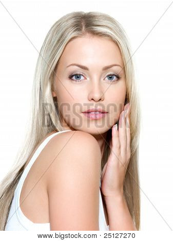 Young Beautiful Woman With Hand On Cheek