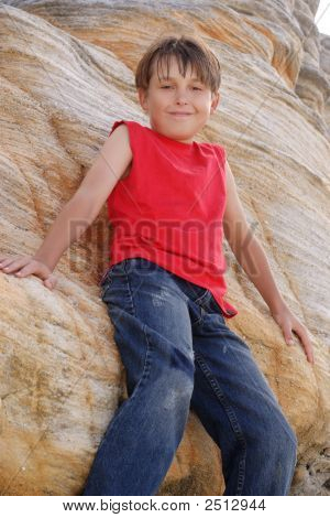 Child Standing By A Rockface