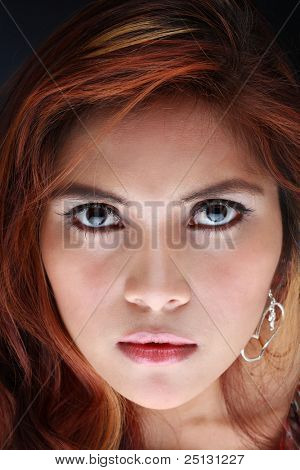 Angry looking Indonesian beauty staring at you.