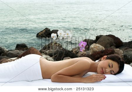 Beautiful woman indulging beauty treatment out in the nature