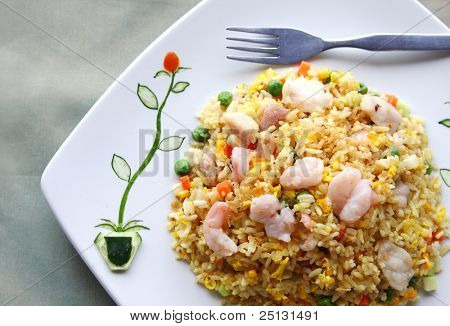 Delicious fried rice with ornament garnish