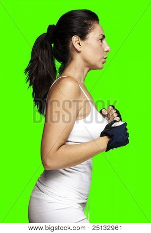 portrait of a sporty middle aged woman running against a removable chroma key background