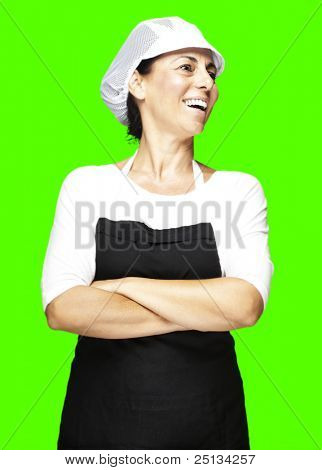 portrait of a middle aged woman smiling against a removable chroma key background