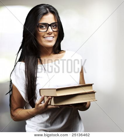portrait of young student holding books indoor