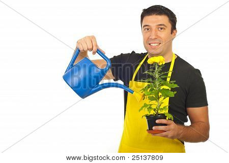 Gardener Holding Watering Can And Flower