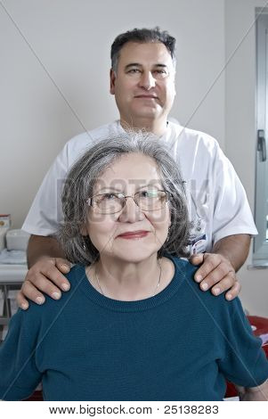 Doctor With Mature Patient
