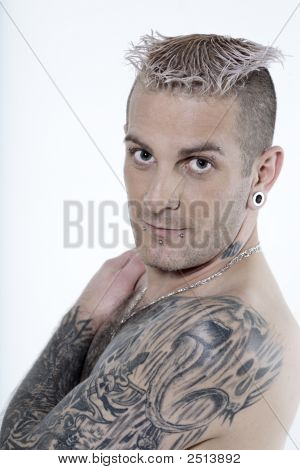 Man With Piercing And Tattoos