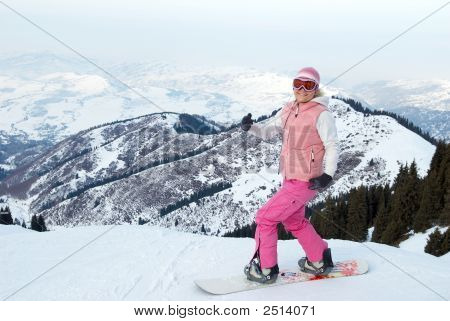 Merry Snowboard Girl Before Downhill With Mouting Pass