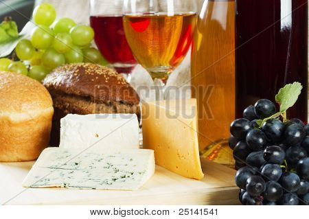 Wine and grapes on vintage background