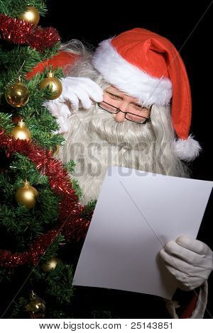 Santa Claus reading wish list