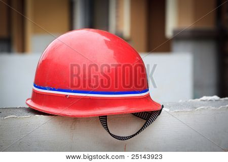 Red hard hat on a wall at a constuction site