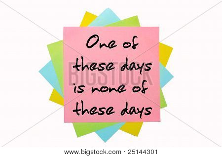 "Proverb "" One Of These Days Is None Of These Days "" Written On Bunch Of Sticky Notes"