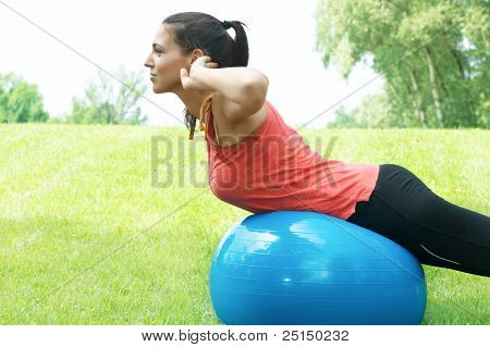 Fitness Girl Doing Exercise With Pilates Ball Outdoors