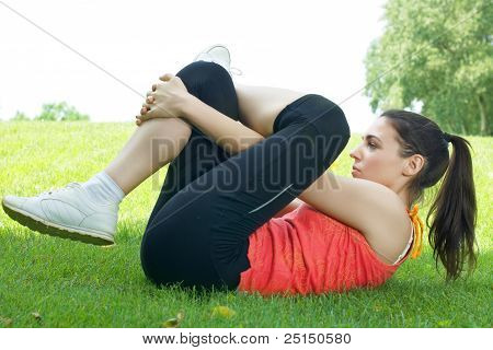 Active Young Women Doing Stretching Exercise Outdoors