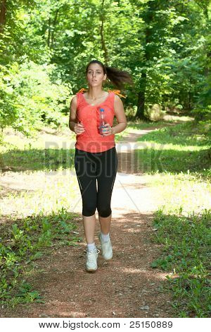 Fitness Girl Jogging Through The Woods In Summer