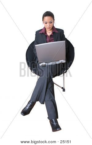 Asian Business Woman On A Laptop In Chair Over White