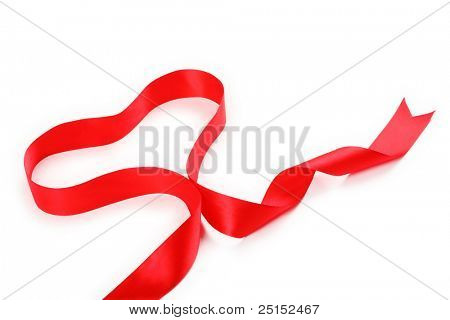 Shiny red satin ribbon with heart shape on white background with copy space. Macro with extremely shallow dof.