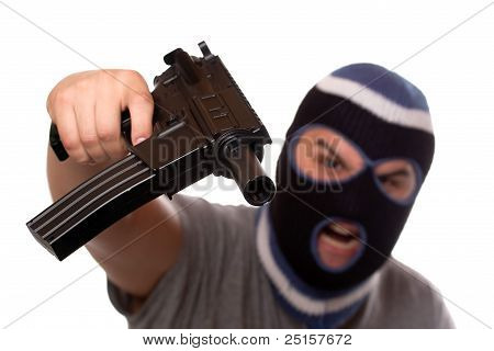 Terrorist Pointing An Automatic Weapon