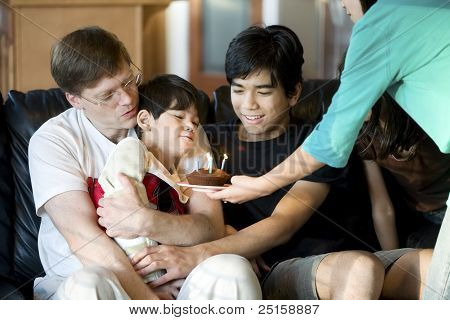 Disabled Five Year Old Boy Blowing Out Birthday Candles