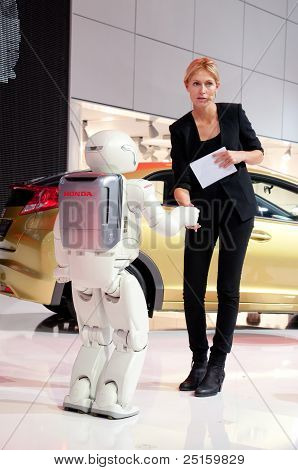 Human And Robot Are Shaking Hands